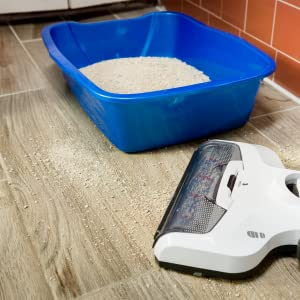 iFloor cleaning kitty litter from a tile floor