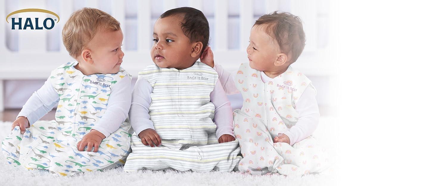 3 babies sitting in sleep sacks