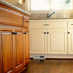 Cabinets in a kitchen n wood and painted cream