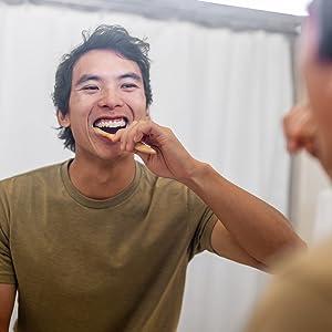 Man Brushing teeth with Dr. Gingeramp;#39;s toothpaste