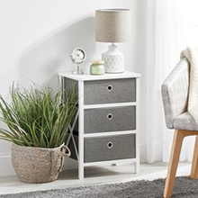 Natural woven basket with plant, 4 gray fabric drawer white end table, lamp, chair, curtains