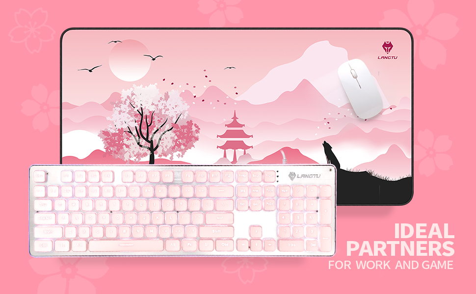 pink mouse pad and keyboard
