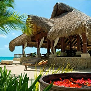 A thatched dinning area of a beach resort