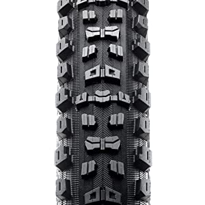 Aggressor mountain bike tire, top view showing tread. Big tread blocks on side, smaller middle