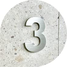 3 on beige quarry wall
