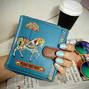 Horse Printed Loop wallet in hand, morning coffee and newspaper time