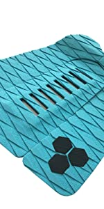 Traction pad for surfboard