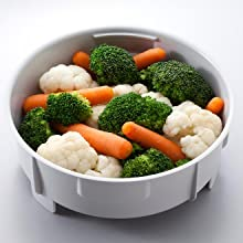 steaming basket with steamed broccoli, cauliflower and carrots