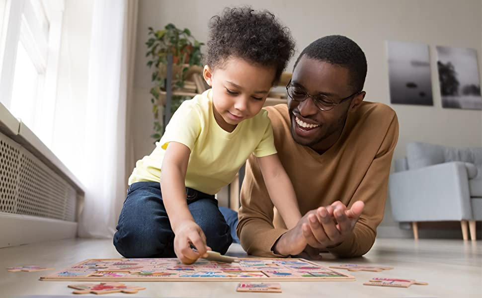 Child and Father playing with ArtzoFun's alphabet uppercase and lowercase puzzle.