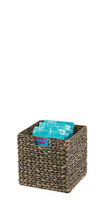 Black Hyacinth Woven Kitchen Pantry Storage Basket with Handles Containing Bags of Dry Snack Food