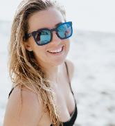 women at the beach wearing Zeal Optics Lolo sunglasses
