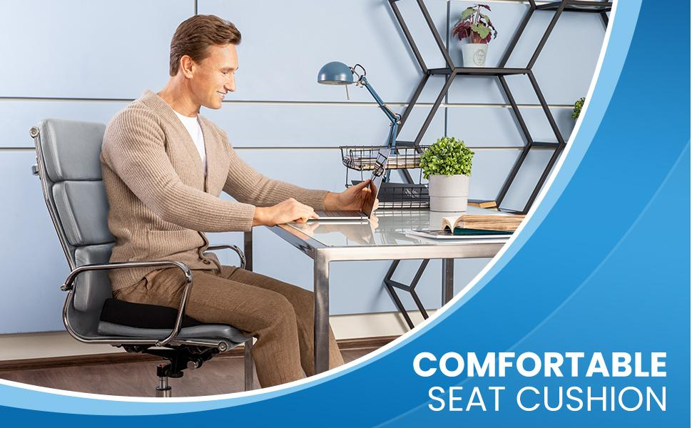 Smiling man in office sitting in chair using the Everlasting Comfort desk chair cushion