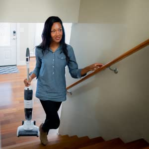 Woman carrying the lightweight iFloor up stairs