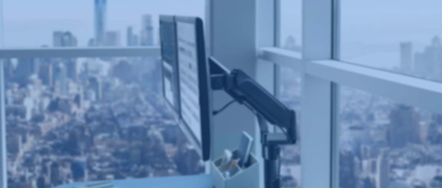 Monitor mounted on desk in city