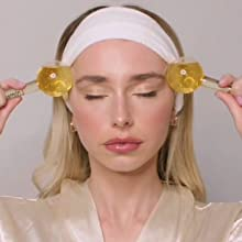 Image showing female using ice globes to soothe and massage the temples.