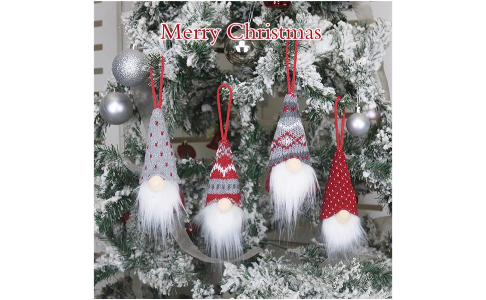 Merry Christmas Four cute dwarf Santas hanging on the Christmas tree