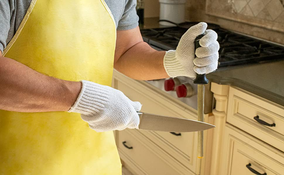 Bison Life white knit butcher gloves in use in a kitchen.