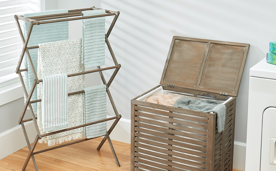 wood hamper storage box and expandable drying rack holding laundry in a laundry room setting