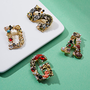 initial letter brooch