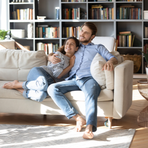 Couple in living room with their feet on an indoor area rug