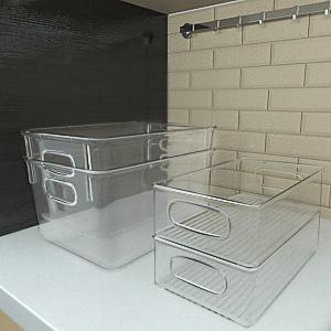 Boîte de rangement empilable pour réfrigérateur.