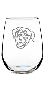 Adorable design of a happy Rottweiler face, engraved onto a stemless wine glass