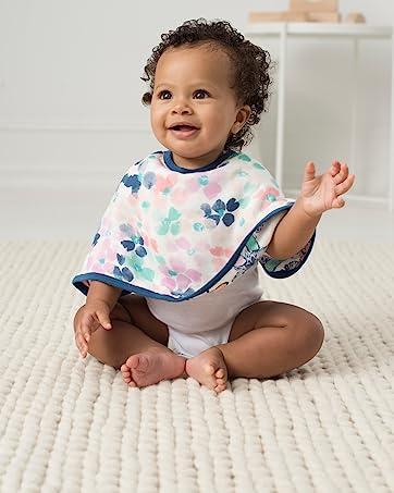 baby sitting up wearing bib
