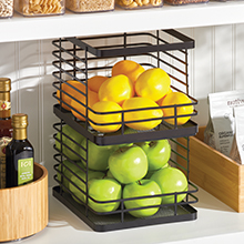 Two Black Metal Wire Storage Baskets with Apples and Lemons Stacked on Kitchen Pantry Shelf