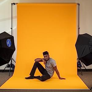 Male model posing on Savage Marmalade Seamless Paper