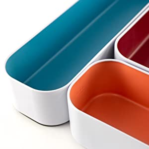 Detail of 3 stacking bins in blue, berry, and sunset