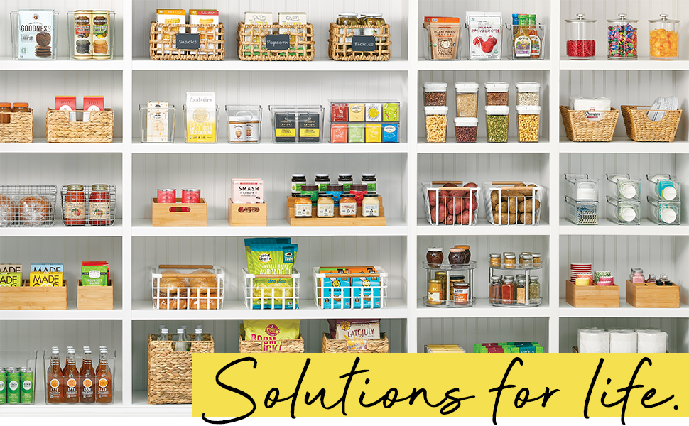 Solutions for Life Heading, antry setting, white shelves, bins, baskets holding organized food items