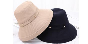 black bucket hat beige bucket hat