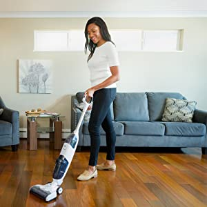 Woman using iFloor Complete in a living room setting