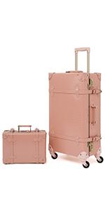 Pink alligator suitcase