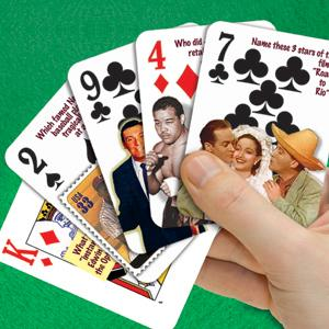 Hand holding Flickback Trivia Challenge Playing Cards five cards with questions.