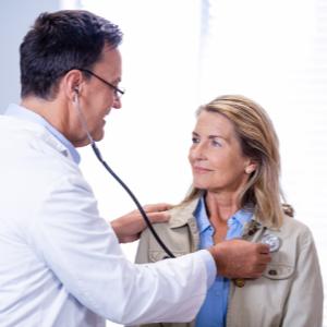 Dr. Paul's Piggy Paste Dr. examining female patient