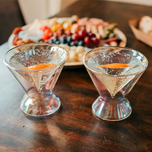 dragon glassware iridescent martini glasses on table with food