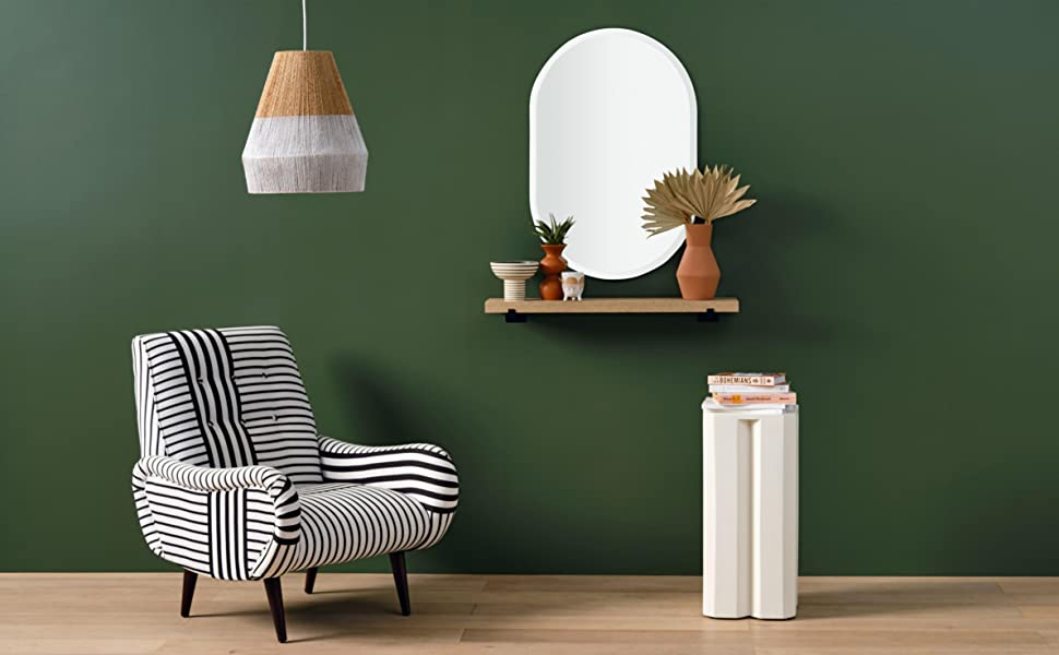 Green living room scene with oblong oval mirror