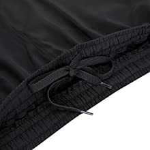 Elastic waistband with internal drawstring. The Split-leg design provides full range of leg motion