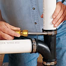 Retrofitting drainpipes by installing a no-hub flexible fitting for greater ease.
