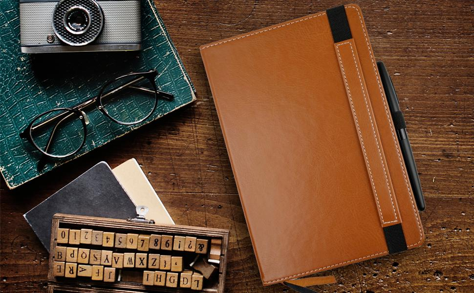 primo brown faux leather notebook on desk with pen in pen loop
