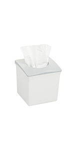 Angled view of the Ubbi tissue box holder with a tissue sticking out the top
