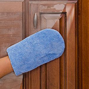 Hand in mitt restoring cabinets with Rejuvenate Cabinet amp; Furniture Restorer