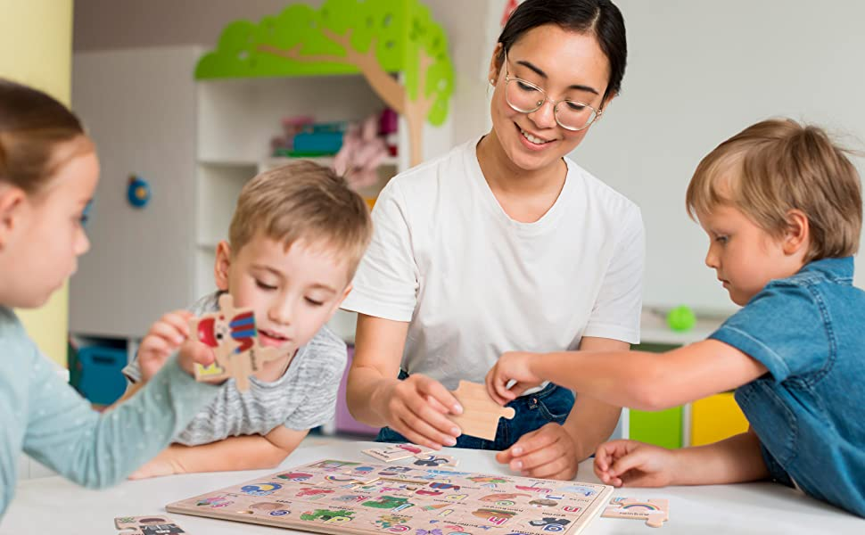 Pre-K teacher playing with the puzzle with children