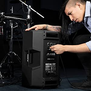 A  MAN CONNECTING  THE ALESIS STRIKE AMP 12