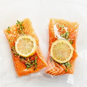 Vacuum sealed salmon with lemon slices
