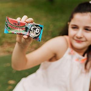little girl fruit snack bar outside park jungle gym vegan chewy kids friendly back to school smile