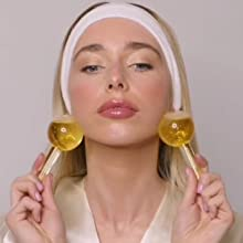 Image showing female using ice globes to soothe and massage the jawline.