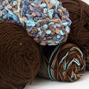 different types of yarn in shades of brown and blue bundles
