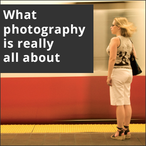 Picture of woman on a train platform. White text reads, What photography is really about.